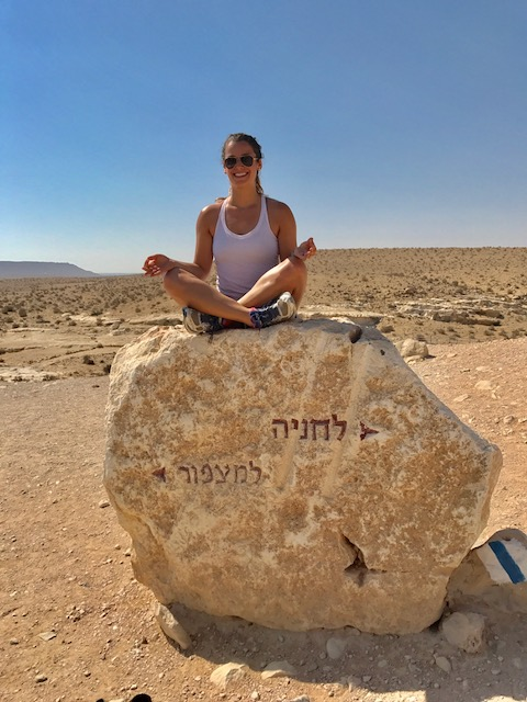 Girl sitting on rock in Negev, Israel