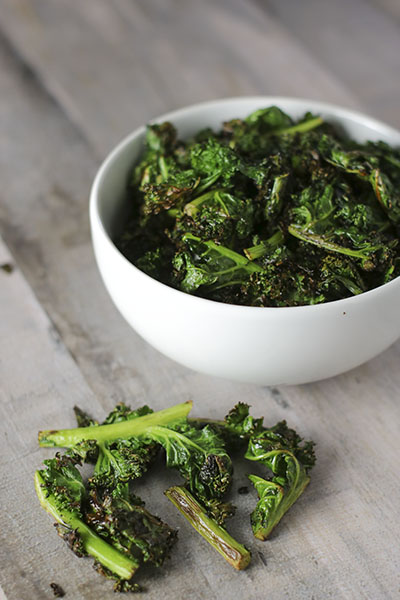 Salty, crunchy, and incredibly easy Pan-Fried Crispy Kale Chips! Enjoy as a fun, healthy snack or delicious side - faster to make than oven-baked kale chips. You will not be disappointed! | NOMaste Kitchen