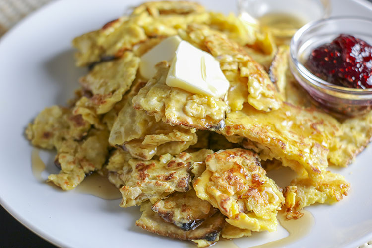 Egg soaked matzah, seasoned with salt, then fried in a hot buttered skillet - Matzo Brei is the perfect dish for breakfast, brunch or brinner whether you are observing Passover or not. Crispy on the outside, moist on the inside, drizzled with warm maple syrup and salt... the ultimate combination of savory and sweet. | NOMaste Kitchen