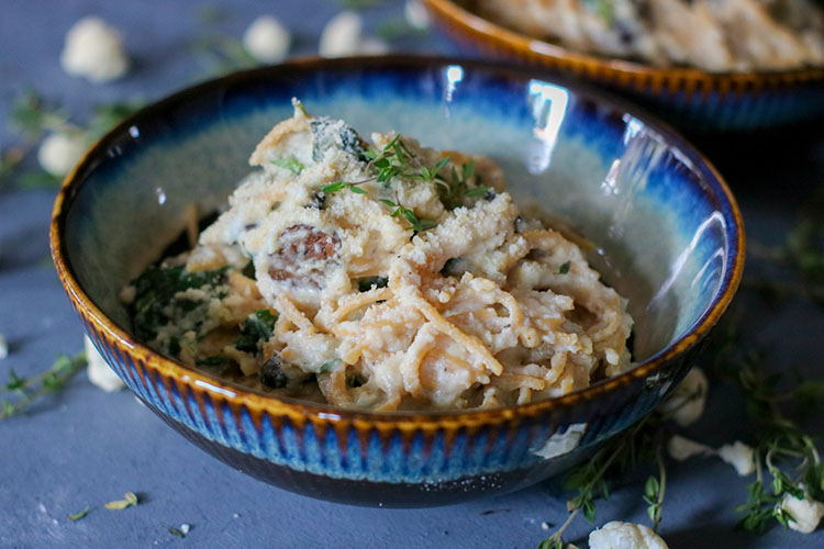 Healthy lentil pasta, nutrient-packed spinach and flavorful mushrooms, all coated in a deliciously light Cauliflower Cream Sauce. This Cauliflower Cream Lentil Pasta is the perfect dish to satisfy your creamy pasta cravings without budging the scale!   NOMaste Kitchen