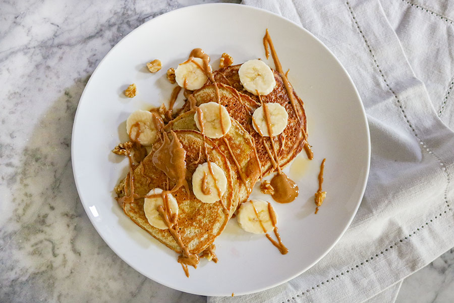 These Healthy Banana Oatmeal Pancakes are thick, rich, and flavorful, with just a slight hint of banana! They taste incredible with maple syrup, nut butter, or even your favorite preserves! I love to top mine with some additional sliced bananas or fresh strawberries! Enjoy them in a large stack, or as a small snack! | NOMaste Kitchen