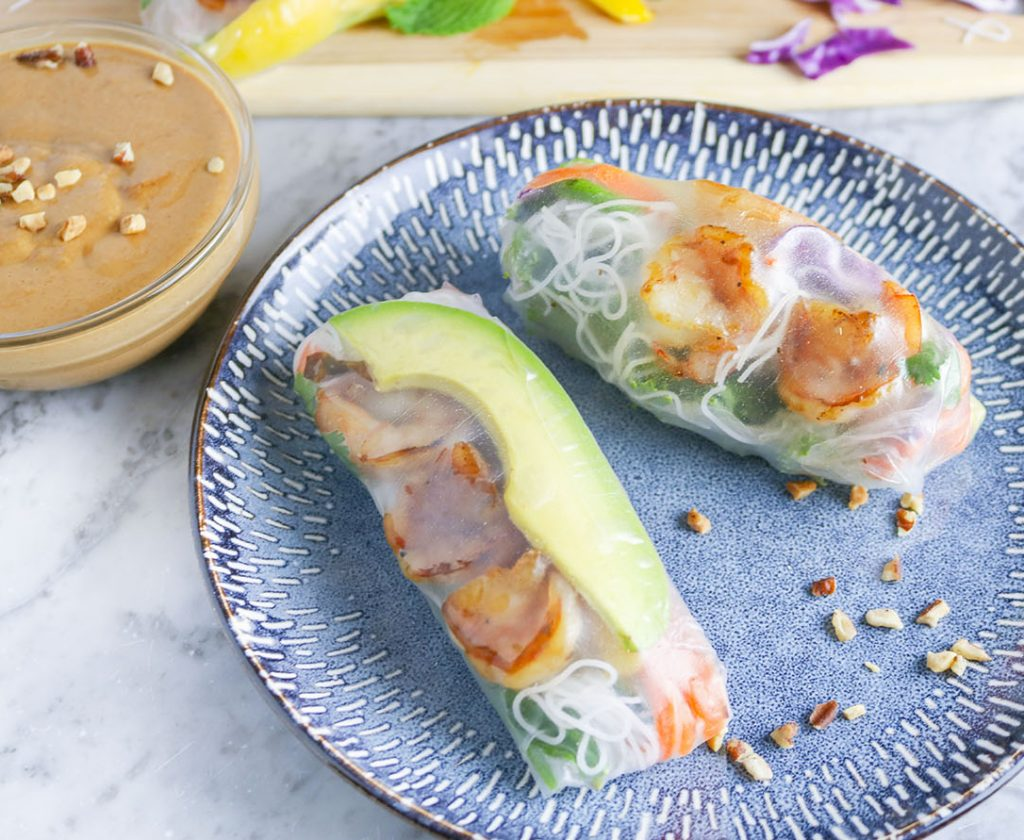 Tender shrimp, creamy avocado, crunchy vegetables, and fresh herbs, all topped with vermicelli and wrapped in rice paper - enjoy w/ Spicy Thai Peanut Sauce. | NOMaste Kitchen