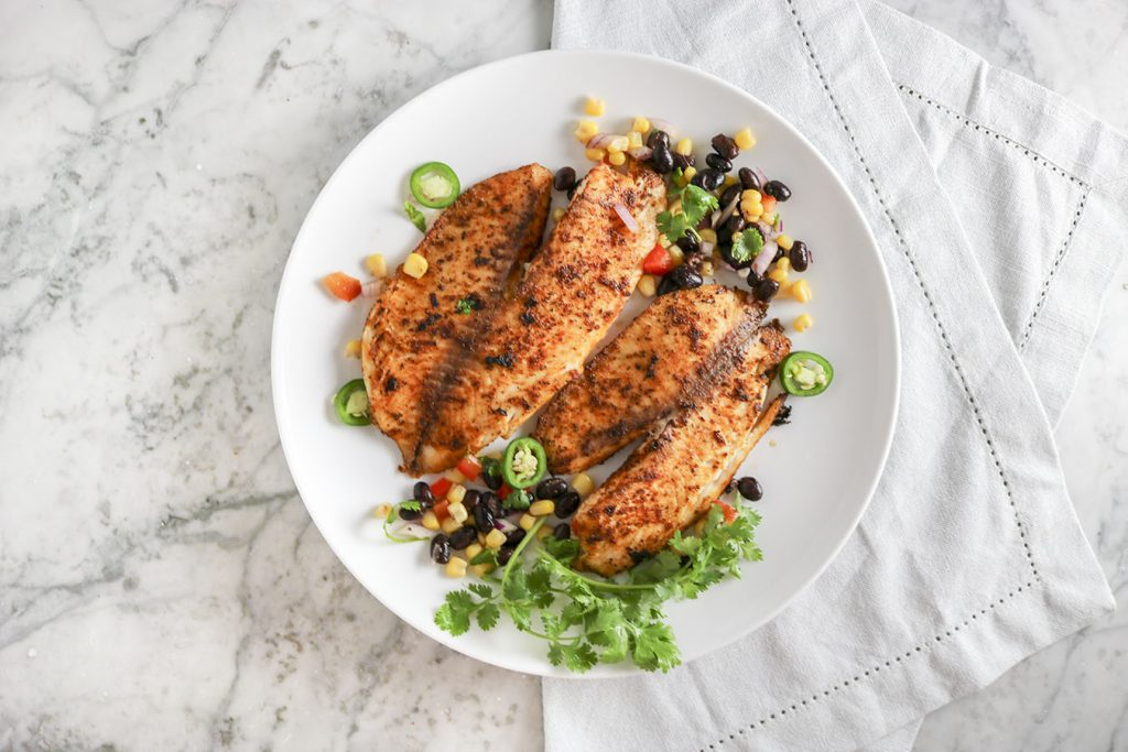 EASY Fish Tacos - PERFECT for summer! Bright and bold, with just a touch of heat - Top with black bean and corn salad, avocado, and more! | NOMaste Kitchen