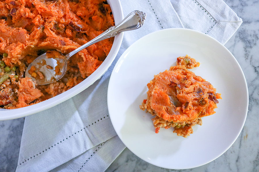 Comfort food does not have to mean bad food! Check out this healthy-spin on the traditional Shepherd's Pie - made with ground turkey and sweet potato. | NOMaste Kitchen