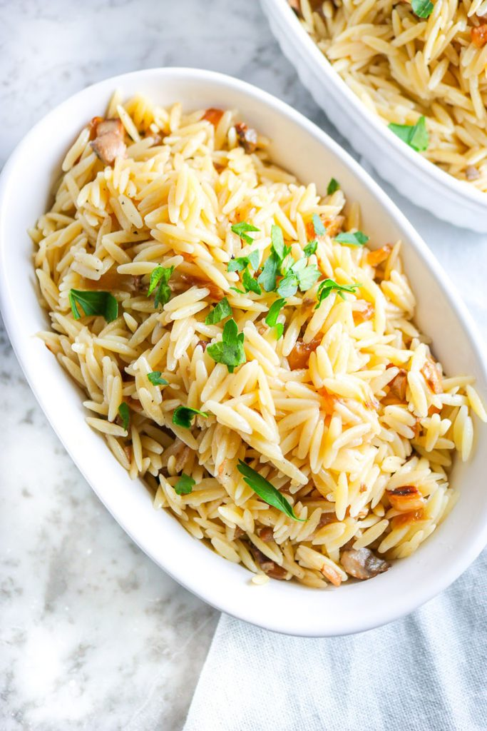 Buttery baby orzo noodles tossed with succulent baby bella mushrooms and rich caramelized onions. Enjoy this recipe as an easy side dish to serve with lean meat, seafood, and/or vegetables! | NOMaste Kitchen