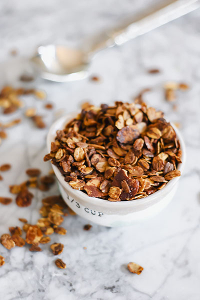 Crispy crunchy and light - this Healthy Homemade Vanilla Almond Granola is the perfect addition to your morning breakfast or afternoon snack. | NOMaste Kitchen