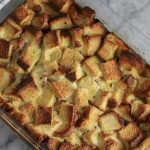 Warm, buttery, cinnamon sugar coats the bottom of each succulent piece of french toast. Fluffy french bread soaks up all the eggy goodness and remains moist even after 40 minutes in the oven. I guarantee this Overnight French Toast Casserole will become one of your family's favorites as well! | NOMaste Kitchen