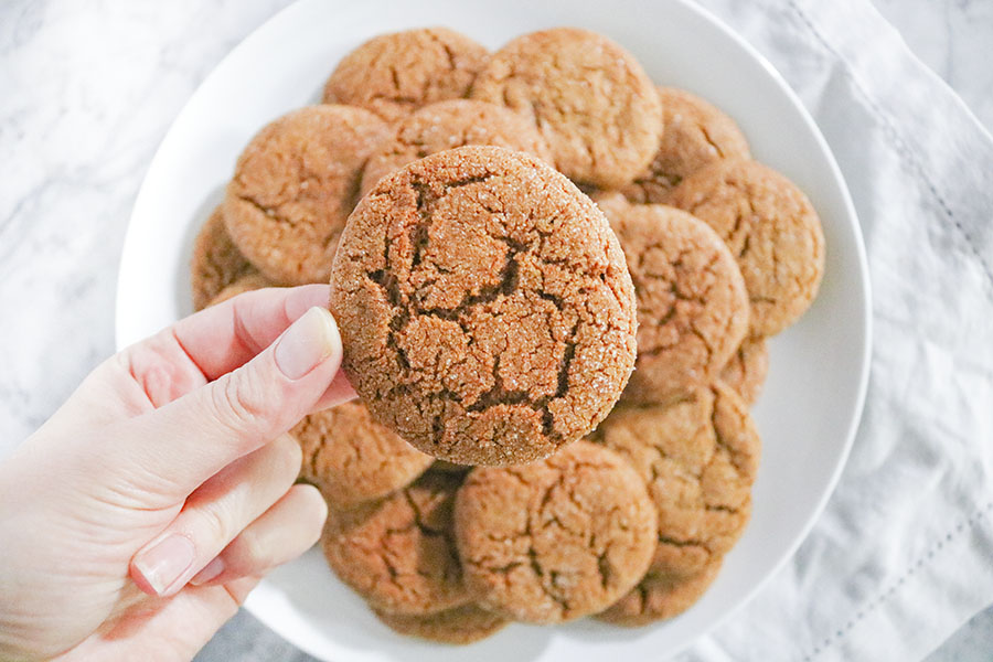 These Molasses Crinkle cookies have been a holiday tradition since started baking way back when as a little kid. Rich, chewy molasses cookies spiked with a dash of hot cayenne pepper, then rolled in sugar before baking. | NOMaste Kitchen